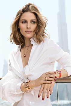 Who made Olivia Palermo's white shirt, gold jewelry, and red watch?