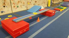 """Preschool Gymnastics: May 2015 Week 1 """"Sports! Walk to middle of beam and do a V sit. Stand up and continue to walk to end of the beam. Gymnastics Warm Ups, Gymnastics Games, Gymnastics Lessons, Preschool Gymnastics, Gymnastics Equipment, Gymnastics Coaching, Preschool Class, Preschool Lessons, Preschool Activities"""