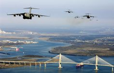 Fifteen C-17 Globemaster III Planes Flying Over the City of Charleston SC.  Fifteen C-17 Globemaster IIIs from Charleston Air Force Base, S.C., fly over the city of Charleston's Arthur J. Ravenel Bridge Dec. 20 during a training exercise. (U.S. Air Force photo/Staff Sgt. James L. Harper Jr