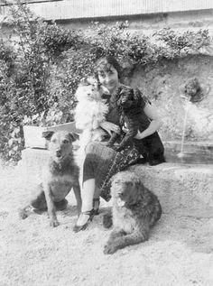 Singer, Actress, Austria Friederika Masaryk, with her dogs in Garmisch-Partenkirchen. c. 1922