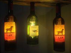 Wine bottle chandelier/duck decoy by 8SIX9Design on Etsy https://www.etsy.com/listing/238628579/wine-bottle-chandelierduck-decoy