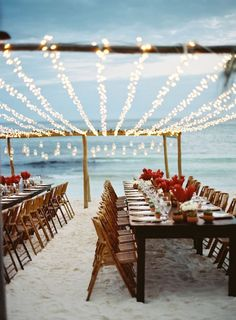 Beach Wedding   Lights   Red Flowers   Photography: TEC PETAJA