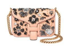 FIRST BLUSH With a little glitter and romance à la Rodarte, a simple Coach x Rodarte crossbody positively blooms. $795; coach.com.