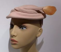 Isn't it always the right time for a vintage pink 1950s Mallory pink pillbox hat! Especially when it has a feather!