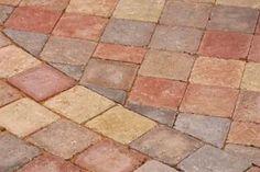 Painting concrete pavers gives a patio a unique appearance.