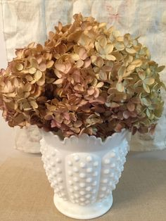 A personal favorite from my Etsy shop https://www.etsy.com/listing/253288532/fenton-hobnail-milk-glass-vase-candy