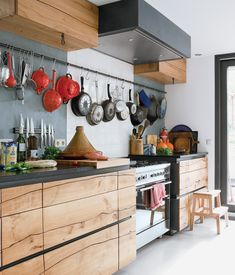 AT THE ELM Local carpenter Crisow von Schulz constructed the cabinets in this Amsterdam houseboat kitchen from a single elm tree. The orga...