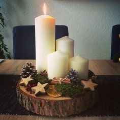 Rustic Christmas Decorations - White Candles on Bark Slice with Other Rustic Ornaments