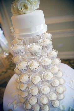 Wedding cupcake tower with filigree cupcake wrappers.