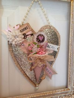 Love the glitter heart with all the wonderfully vintage feel embellishments!
