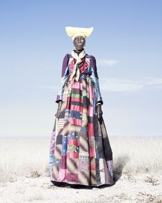 Step back into the past and enjoy these portraits of Herero tribe members of Namibia. The pictures show residents wearing Victorian era dresses and paramilitary costume as a direct result. Victorian Era Dresses, Victorian Fashion, Fotojournalismus, Moda Afro, Art Africain, African Textiles, African Patterns, African Fabric, This Is A Book