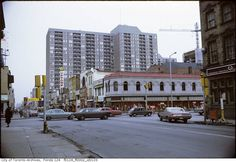 The intersection of Yonge and Bloor has seen a lot of change over the years. Check out our collection of old photographs showing the changes. Toronto Location, Toronto Photos, Yonge Street, North Tower, Royal Ontario Museum, Big Building, Holt Renfrew, Canadian History, Aerial View