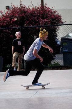 Skater Boy - Yellow beanie hat, blue t-shirt, black skinny jeans, blue sneakers. Black skateboard, white wheels.