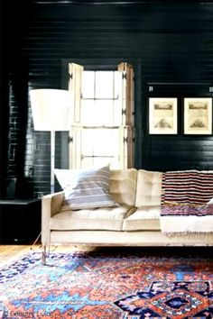 Whether you prefer a whisper or a shout, bring black into your home decor and be elegant and on-trend doing so! The black color trend is here to stay! Black Painted Walls, Black Walls, Living Room Trends, Living Rooms, Hot Pink Room, Monochromatic Room, Black And White Living Room, Traditional Style Homes, Best Paint Colors
