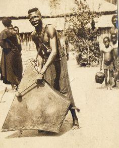 Africa | Batetela man,DR of Congo | 1910 | Flat four-cornered wood drum
