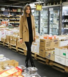 The fashionable way to shop for your groceries! Throw on an all black outfit and a camel coat.