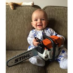 toy stihl chainsaw with kid - Google Search Stihl Chainsaw, Little Man, Our Kids, Motor, Cool Toys, Outdoor Power Equipment, Backdrops, Tree Tattoos, Milling