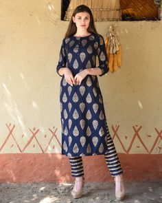 Shop online Navy blue block printed kurta with striped pants Styled with beautiful prints all over the garment, this navy blue kurta paired with the striped pants is sure to evoke warm smiles and looks of admiration Printed Kurti Designs, Salwar Designs, Kurti Neck Designs, Kurta Designs Women, Kurti Designs Party Wear, Dress Neck Designs, Blouse Designs, Long Kurta Designs, Indian Designer Outfits