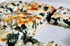 Cheesy Spinach and Artichoke Pizza - -    Not only can you eat this pizza for, say… dinner or lunch, it makes for an awesome appetizer or pre-dinner snack. On a small roundish or rectangle-like crust, the filling sits almost an inch thick. Cheesy, gooey amazingness filled with – say it with me! – VEGETABLES.  http://www.howsweeteats.com/2012/03/cheesy-spinach-and-artichoke-pizza/