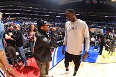 Spike Lee talks with Draymond green during the NBA AllStar Game as a part of 2018 NBA AllStar Weekend at STAPLES Center on February 18 2018 in Los...