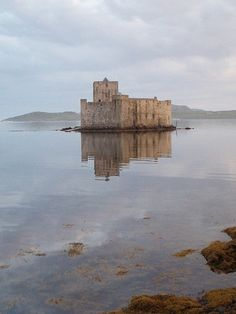 The family cottage.. Kisimul Castle in the Outer Hebrides in Scotland - home of the clan MacNeil