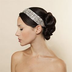 Brides.com: Glamorous Hair Accessories. Band Together  You'll catch winter rays of light in a Swarovski crystal silk satin ribbon headwrap, $575, Jennifer Behr.