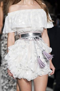 White ruffle, silver belt and lavender tassels. Sweet.   Beautiful Life
