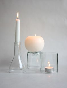 One wine bottle + 3 candles = simplistic repurposing! I'd use a chocolate, black or grey floating shelf, clear or blue wine bottle and white candles. This would also look great above a fireplace.