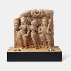 A BUFF SANDSTONE SCULPTURE OF GANGA WITH ATTENDANT AND SHIVA, Central India, Late 10th Century CE, Live Auction, Mumbai, December 17, 2014