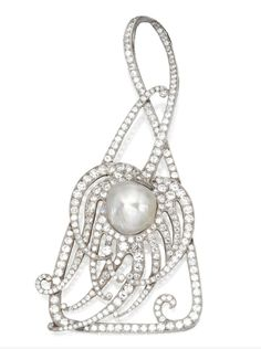 PLATINUM, DIAMOND AND PEARL PENDANT, CIRCA 1910    Designed as a stylized peacock feather set in the center with a baroque button pearl measuring approximately 14.3 by 13.9 by 10.6 mm., further set with old European-cut, round and single-cut diamonds weighing approximately 10.00 carats, signed Tiffany & Co., suspended from a black silk cord.