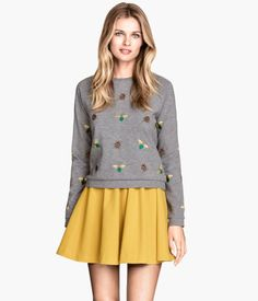H&M Embroidered Sweatshirt $34.95 I do love some insect-themed clothing!