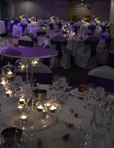 Purple wedding reception with hanging spiral centrepieces. Styled by Greenstone Events.