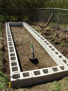 Cinder block edging with hardware and landscape cloths to block pests and weeds.