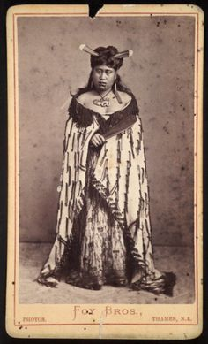 Foy Brothers (Thames) :Unidentified Maori woman with huia feathers in her hair, Thames district