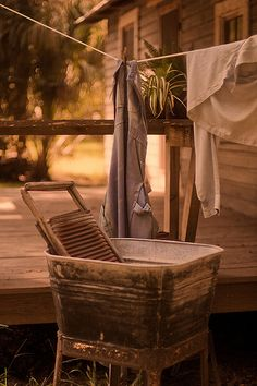 a simpler time . wash tub, washboard + laundry on a clothesline. can't lie,I think I'd totally wash clothes this way!