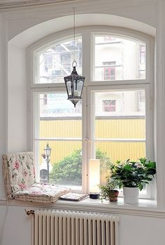 Arch over a casement window with a window seat.