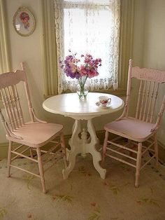 so shabby vintage chairs painted pink with cute little table