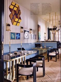 lorenzo castello bronze based tables and blue banquette seating