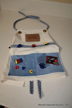 I made this craft apron for my grandson using muslin material, denim, and a patch from an old pair of Levi's.