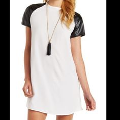 """Charlotte Russe dress Charlotte Russe faux leather sleeve dress. Crew scoop neck & rear gold zipper. Length is 33"""" from shoulder to hem. 🚫 trades❤️ bundle discount only Charlotte Russe Dresses Midi"""