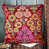 Persian Garden, a stunning bright and colourful design from Kaffe Fassett featuring pink, lilac and yellow flowers
