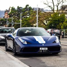 Ferrari 458 Speciale painted in Tour De France Blue w/ White and Light Blue racing stripes  Photo taken by: @intercars on Instagram
