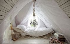 White attic bedroom all in white - with chandelier and fabric galore