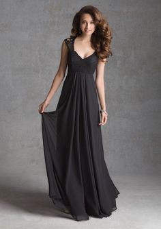 Chiffon bridesmaid dress with lace bodice. Features a sheer lace back and Queen Anne neckline.  Fabric: Chiffon