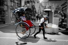 ONLY PLACE IN TOKYO FOR RICKSHAW IS AT SENSOJI TEMPLE (ALSO wearing a KIMONO) Japan in motion -- Japanese pulled rickshaw (jinrikisha) at Asakusa  ALSO: The most famous neighborhood to go for a Jinrikisha ride is Asakusa (See Ebisuya, Jidaiya, Tokyo Rickshaw), but it is also possible to ride one in Yanaka with Otowaya. https://www.japan-rail-pass.com/japan-by-rail/travel-tips/getting-around-in-tokyo