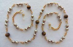 Tigers eye gemstones decorate this handcrafted eyewear holder. Avail. at arepaki.etsy.com