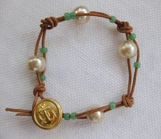 Such a light and delicate little coastal bracelet of vintage pearls, seafoam colored glass beads and a gold anchor button & loop closure. Perfect......@SeaSideStrands