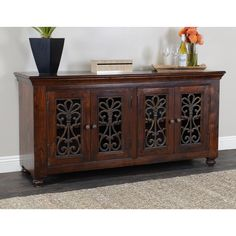 Beautifully crafted from acacia wood and featuring distressed iron highlights, this elegant plasma TV stand makes a handsome addition to any decor. This stand provides roomy storage for accessories and supports televisions of up to 65 inches.