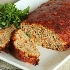 Jam packed with healthy ingredients, this easy turkey meatloaf is topped with a sweet and tangy glaze. The very best dinner ever.