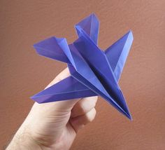 Origami paper airplanes?  Some different ideas for paper airplanes, a bit more involved.  but more decorative!